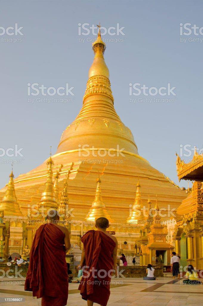 Yangon, Myanmar: Shwedagon Pagoda and Monks in Sunset Light royalty-free stock photo