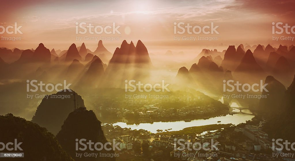 Yangshuo town river Li and karst mountains at sunrise stock photo