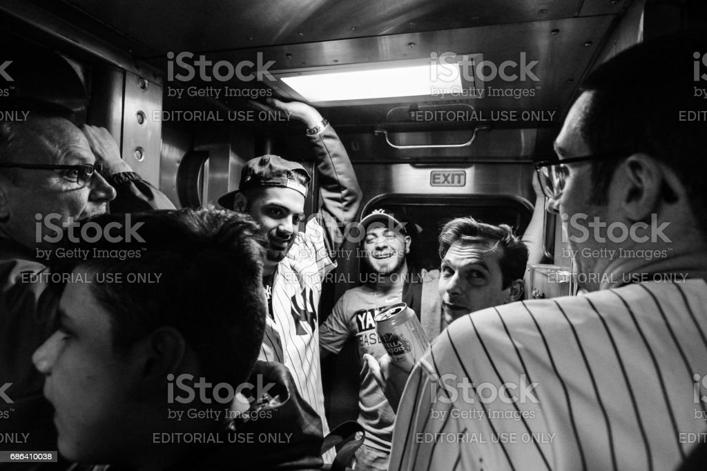 Yankee fans on New York subway stock photo