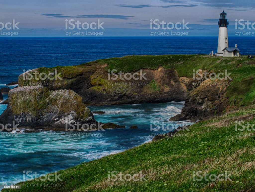Yaquina Head lighthouse and cove in spring, Oregon stock photo