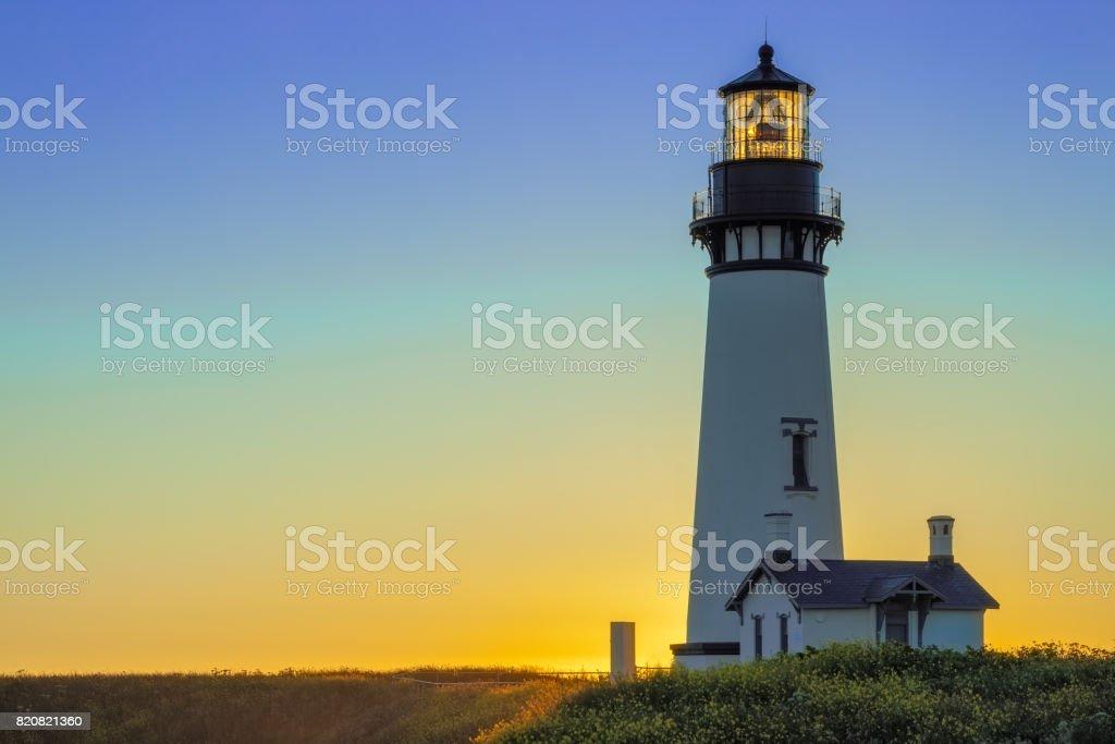 Yaquina Head Lighthouse at Sunset, Oregon, USA stock photo