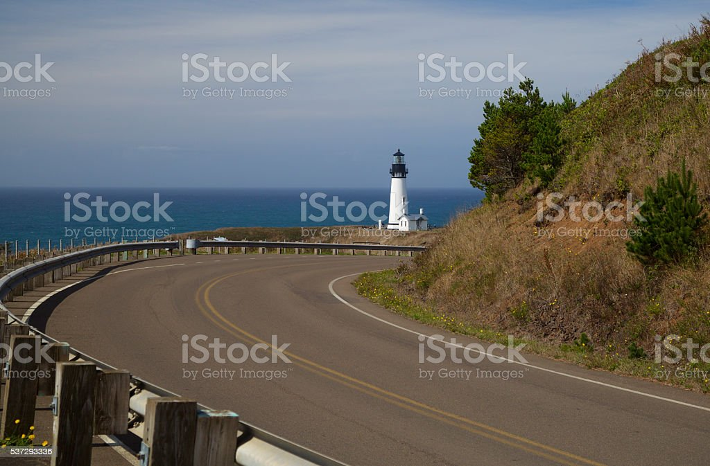 yaquina head lighthouse from the costal highway stock photo