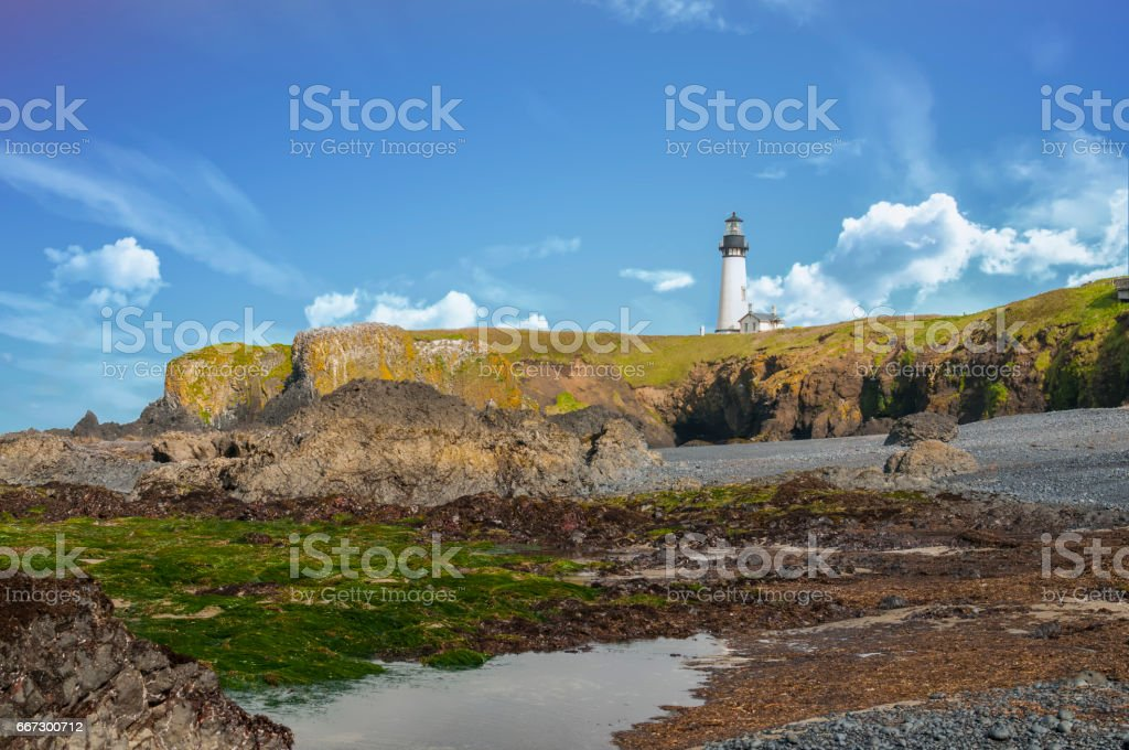 Yaquina Head Lighthouse Oregon Pacific Ocean headland Blue Sky Edited stock photo