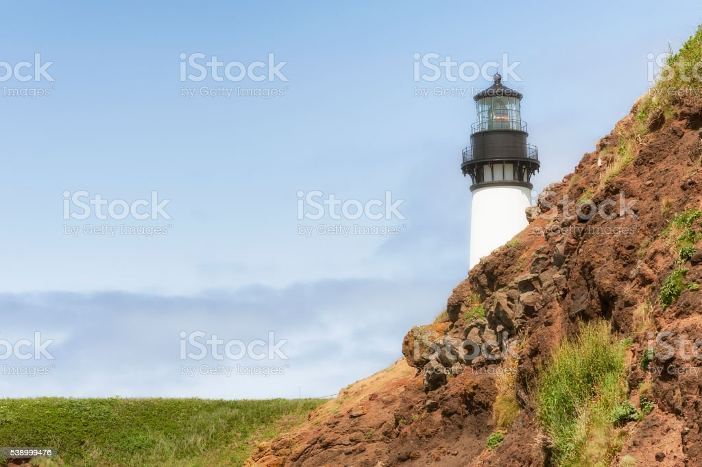 Yaquina Head Lighthouse view from Cobble Beach stock photo