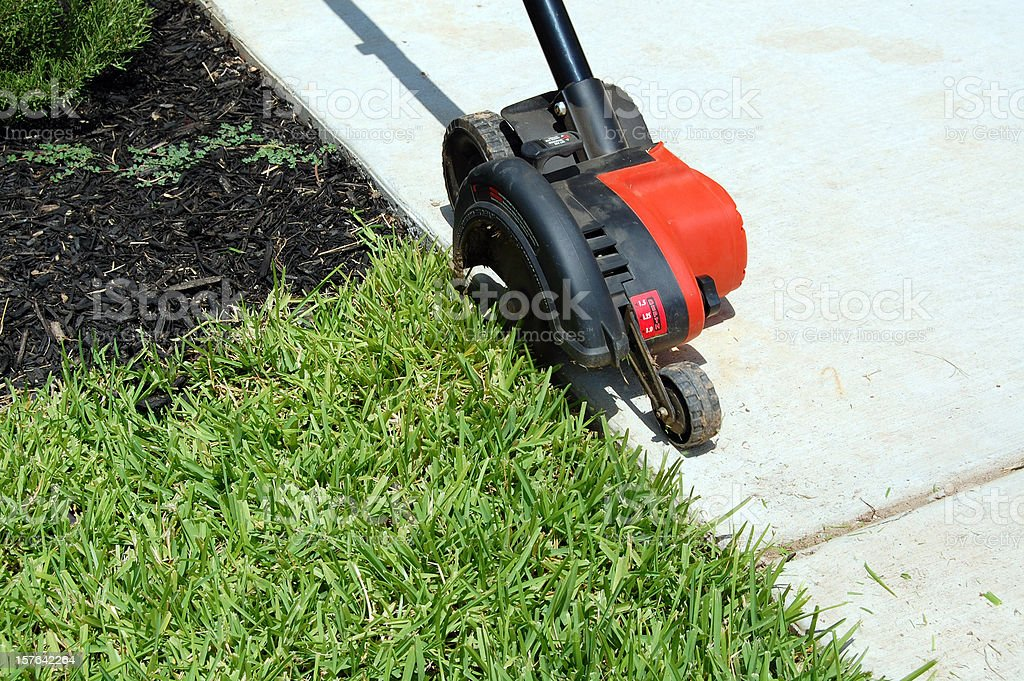 Yard Edger in Action royalty-free stock photo