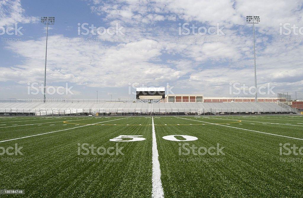 50 yard line in a football stadium stock photo