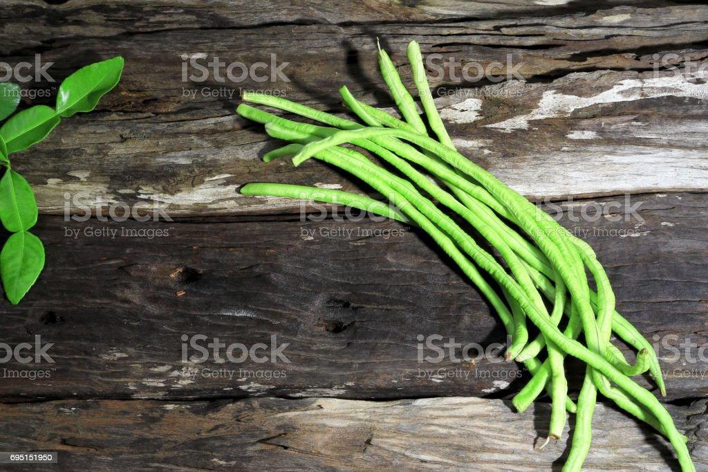 Yard long bean on wooden board background, Dark or Classic Tone. stock photo