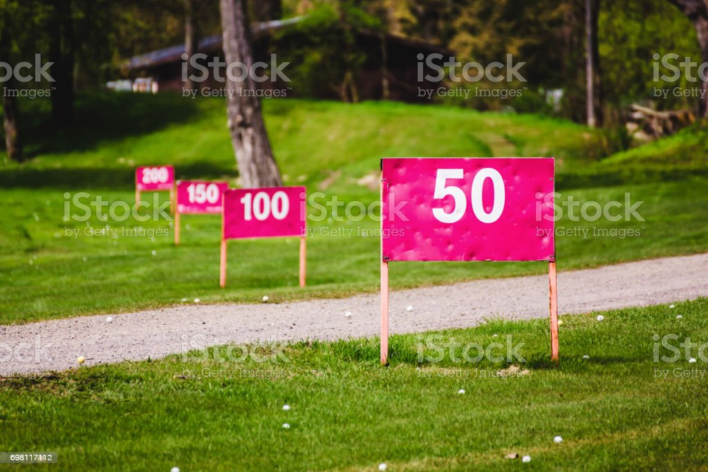 Yard signs in driving range stock photo