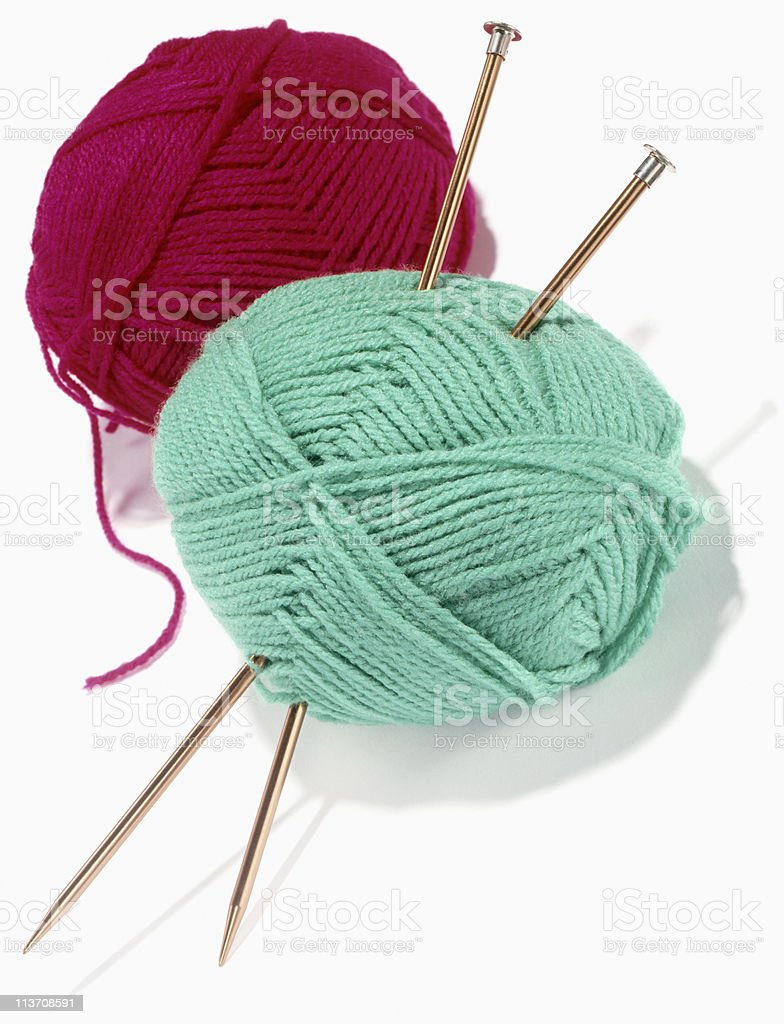Yarn and Knitting Needles cut out on white royalty-free stock photo