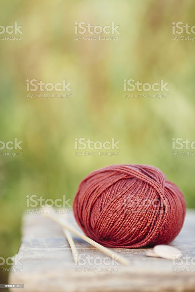 Yarn and knitting needles on a table royalty-free stock photo