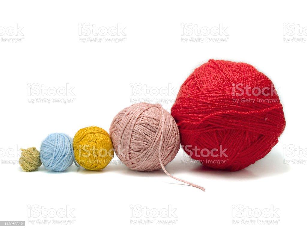 Yarn balls in a row royalty-free stock photo