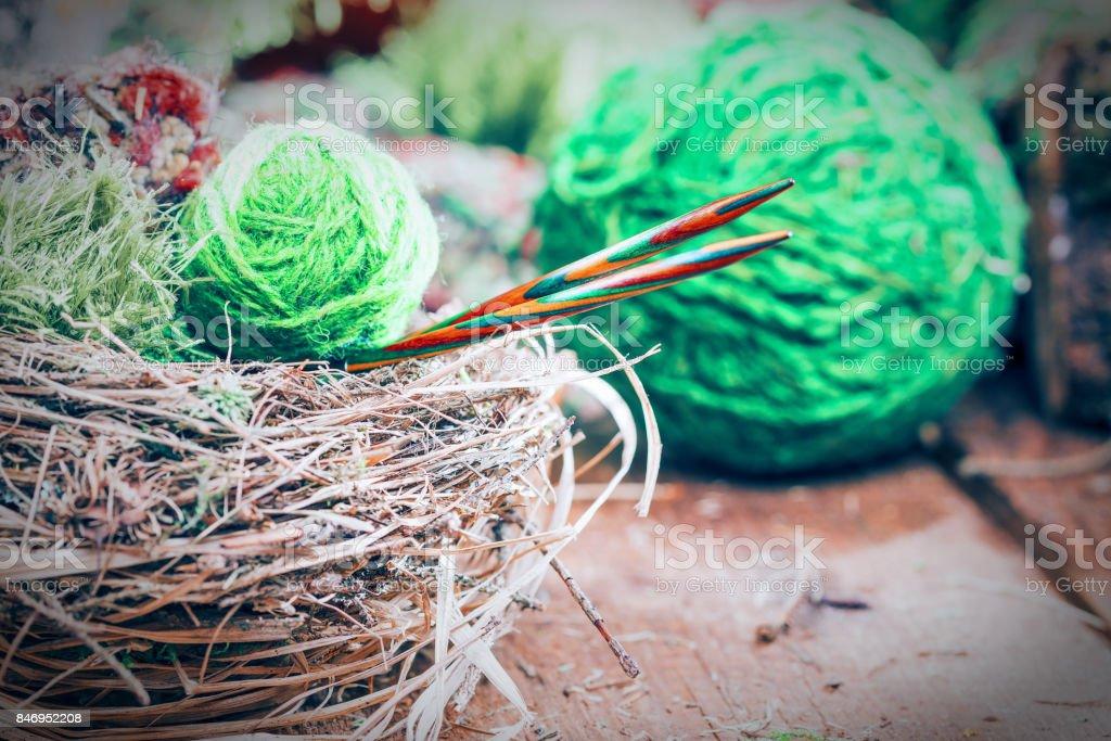 Yarn balls in natural log interior stock photo