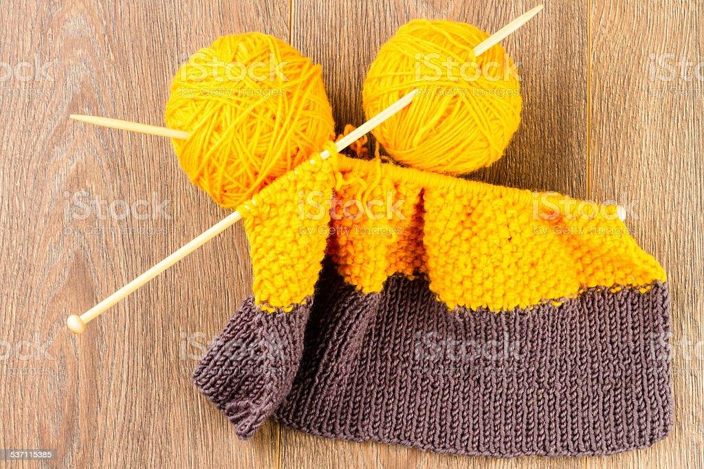 yarn, knitting needles and scarf stock photo