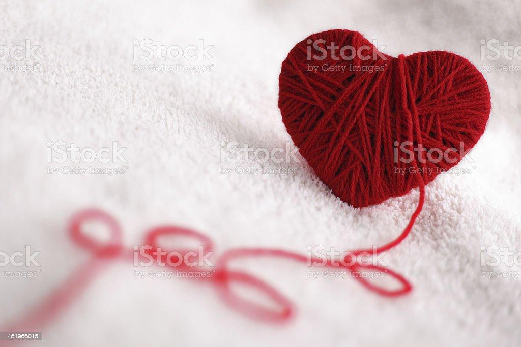 Yarn of wool in heart shape symbol stock photo