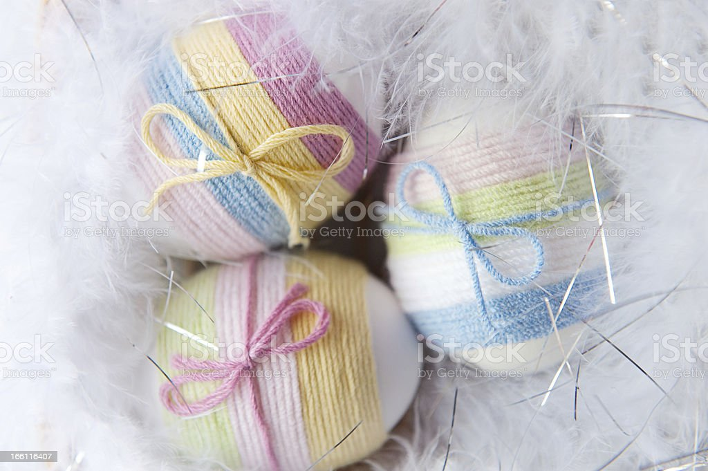 Yarn wrapped Easter eggs royalty-free stock photo