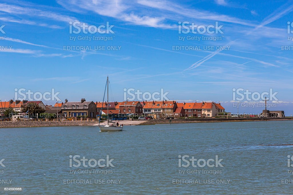 Yatch in front of summer houses at Plage-de-Petit-Fort-Philippe  calais france stock photo
