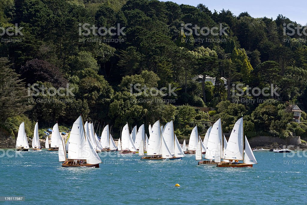 Yawl Sailboat Race in Wooded Valley Estuary stock photo