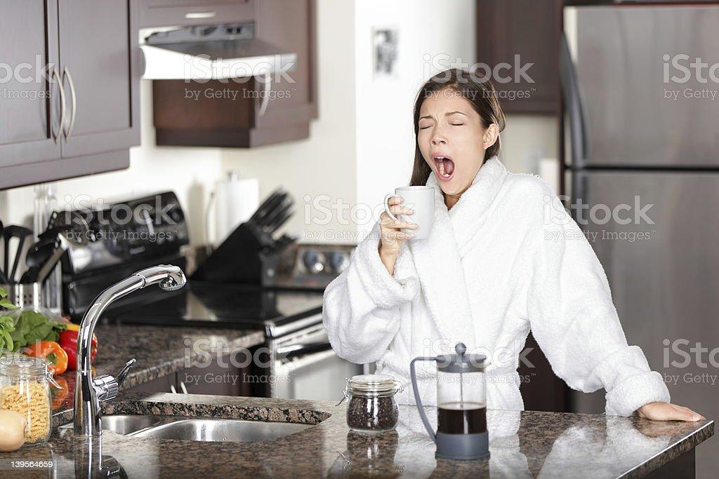 Yawning coffee woman in morning stock photo