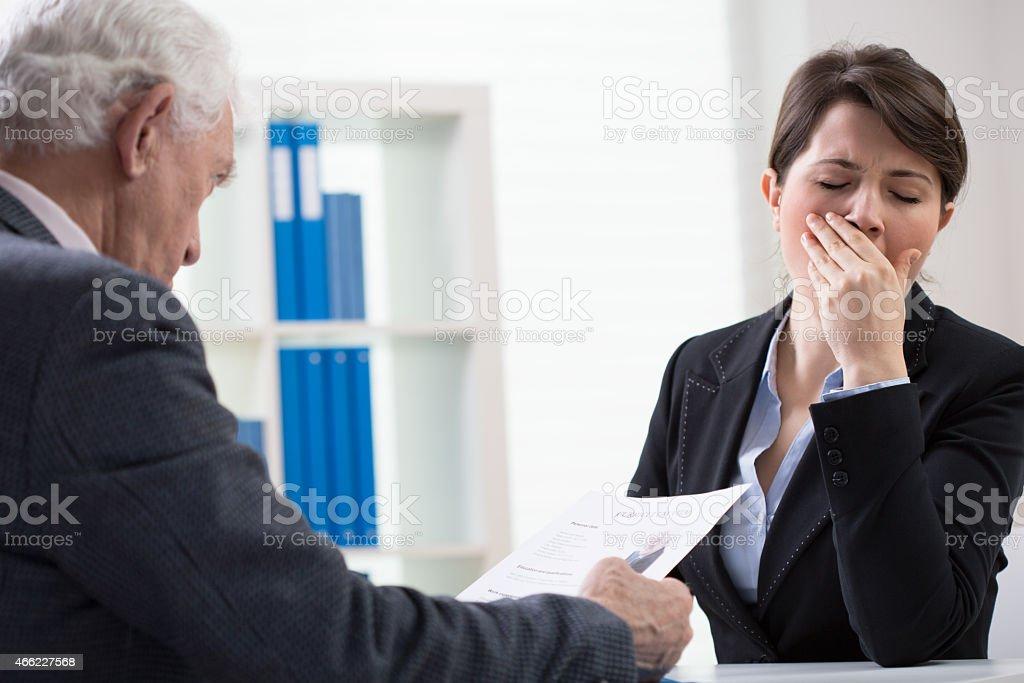 Yawning interviewer stock photo
