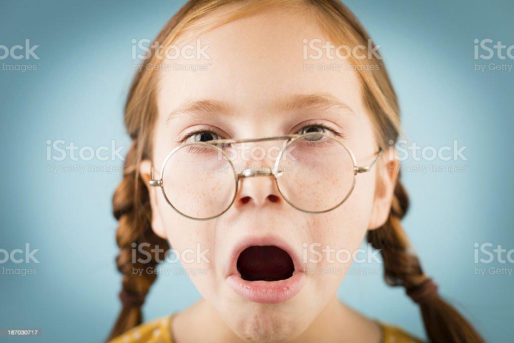 Yawning Little Girl Wearing Vintage, Nerdy Glasses royalty-free stock photo