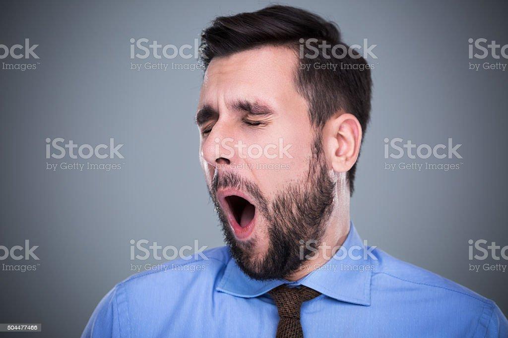 Yawning man stock photo