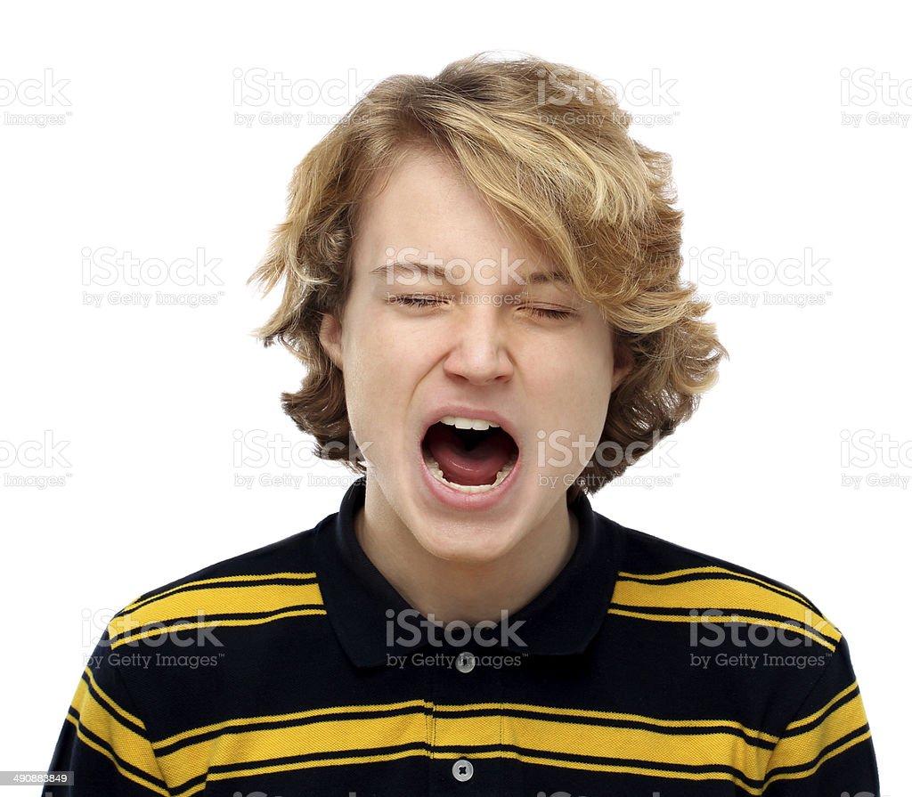 Yawning teenage boy royalty-free stock photo
