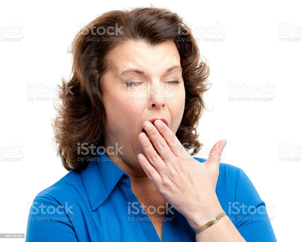 Yawning Woman Covering Mouth stock photo