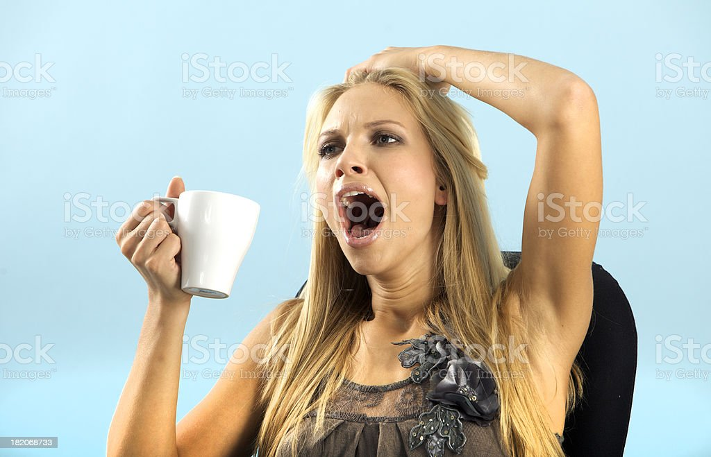 Yawning woman with coffee royalty-free stock photo