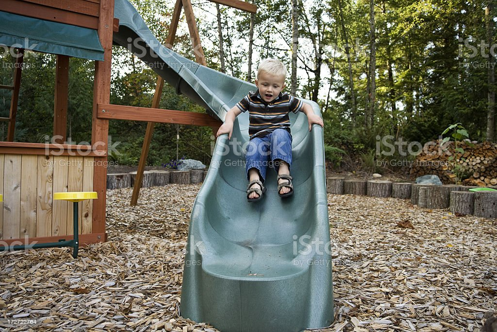 Yeah! little boy on his slide royalty-free stock photo