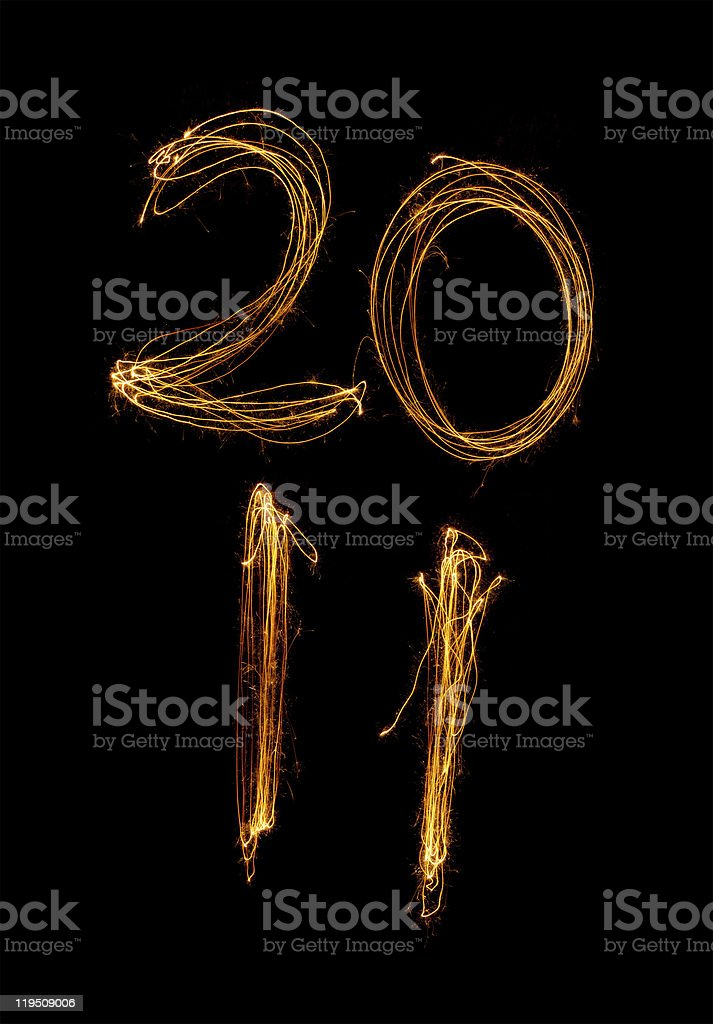 Year 2011 in sparklers on two lines stock photo