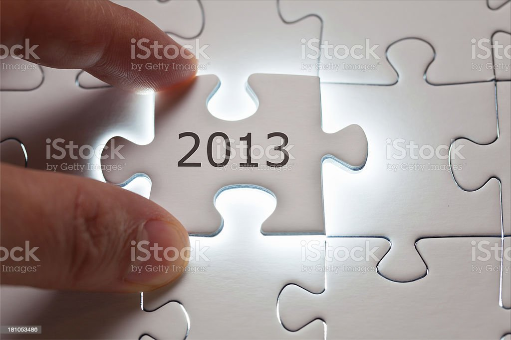 Year 2013 number written on a puzzle piece stock photo