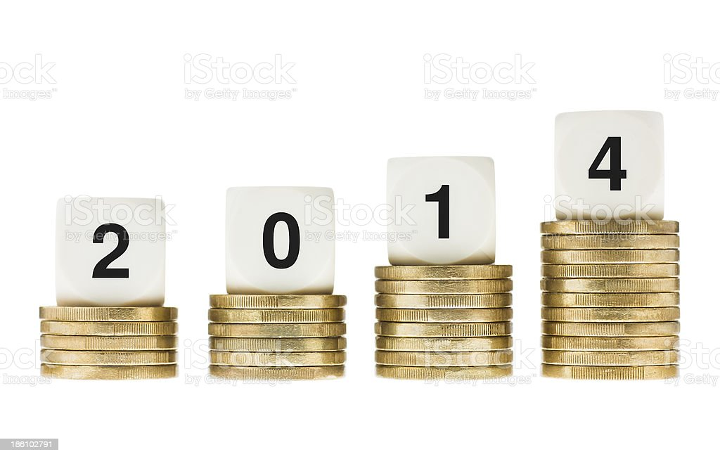 Year 2014 on Stacks of Gold Coins with White Background royalty-free stock photo