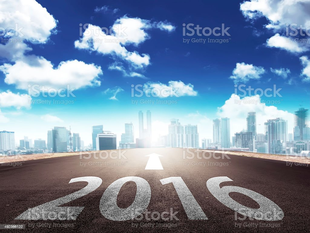 Year 2016 on the street with arrow stock photo