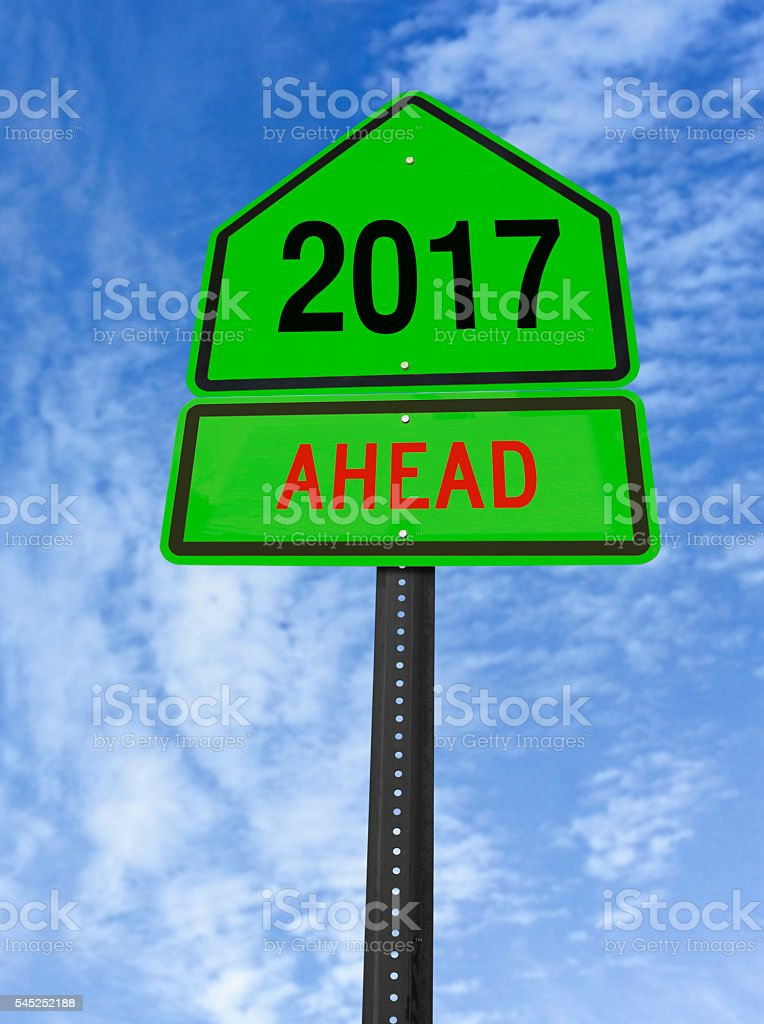 year 2017 ahead roadsign stock photo