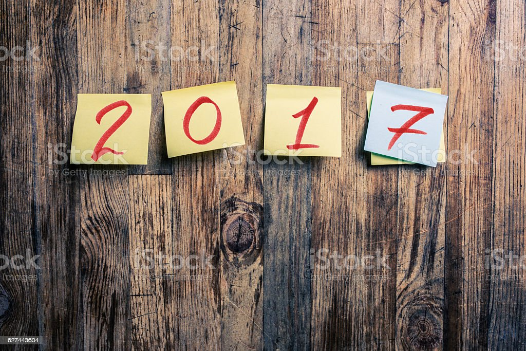 Year 2017 on postits on wooden background stock photo