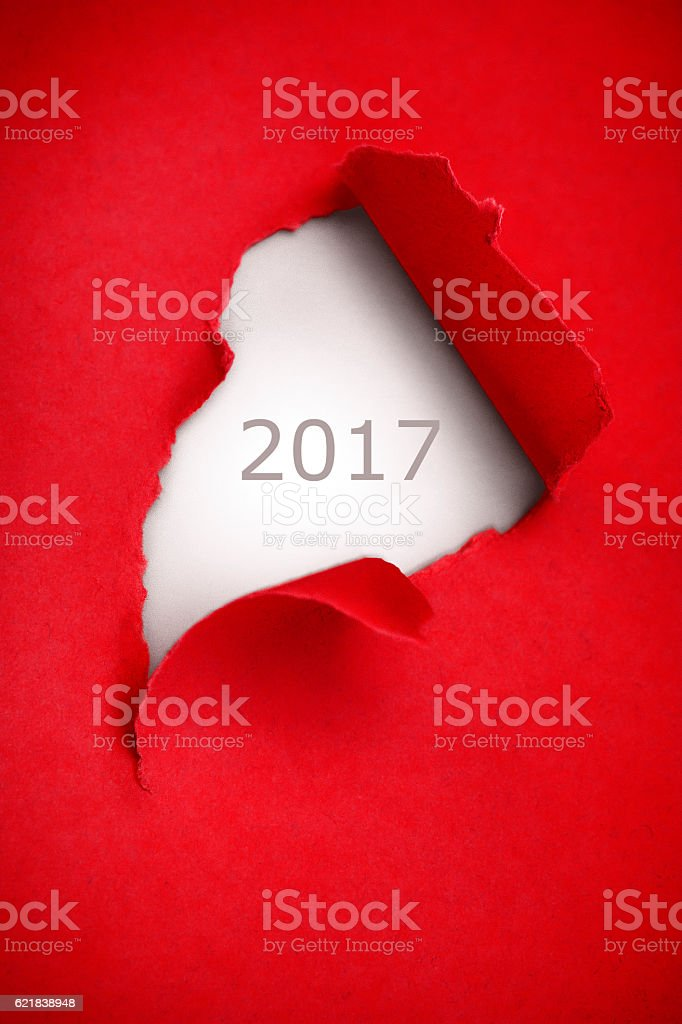 Year 2017 torn red paper stock photo