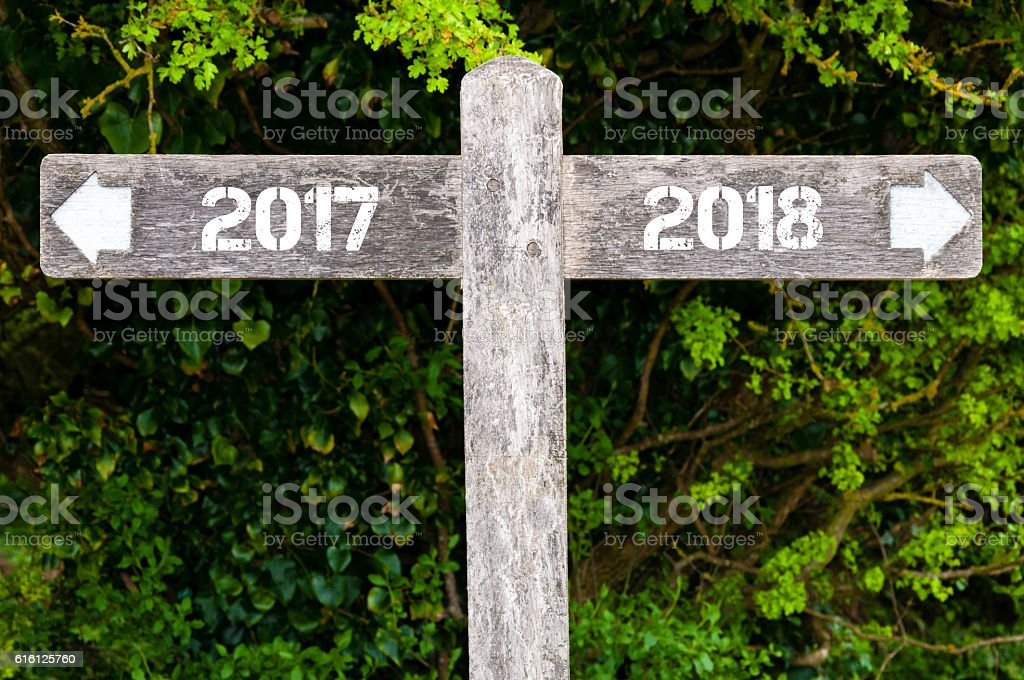 Year 2017 versus 2018 directional signs stock photo