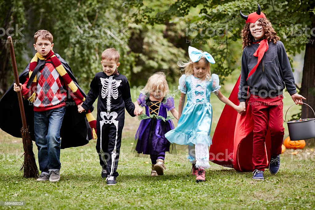 10-11 year children in Halloween stage costumes going to trick-or-treat stock photo