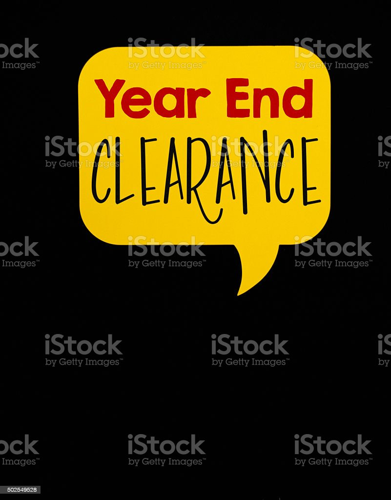 Year End Clearance sale speech bubble on black chalkboard background stock photo