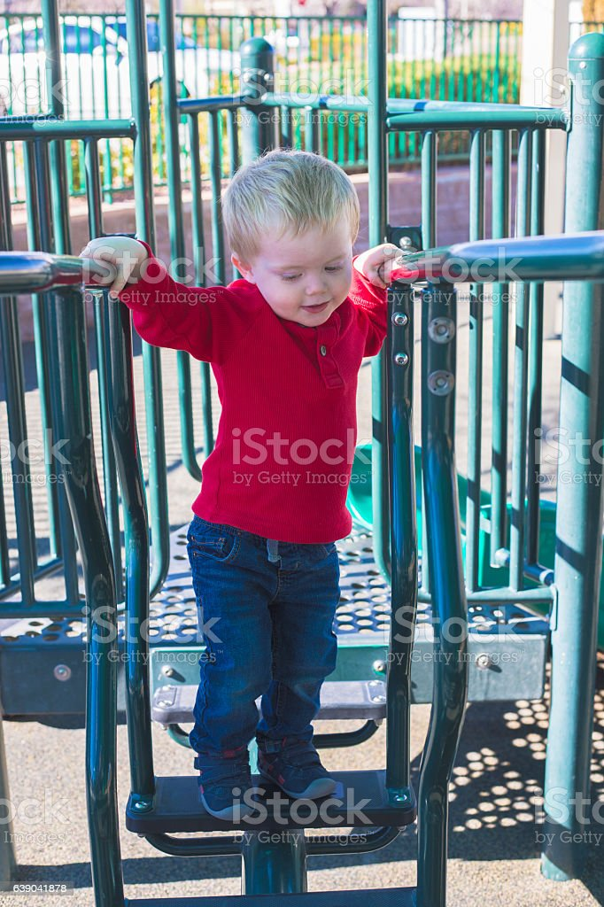 2 year old at the local park stock photo