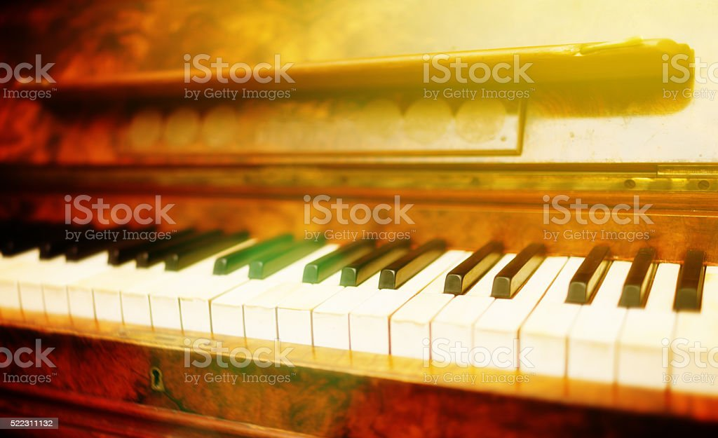 150 year old German piano in gentle afternoon sunlight stock photo