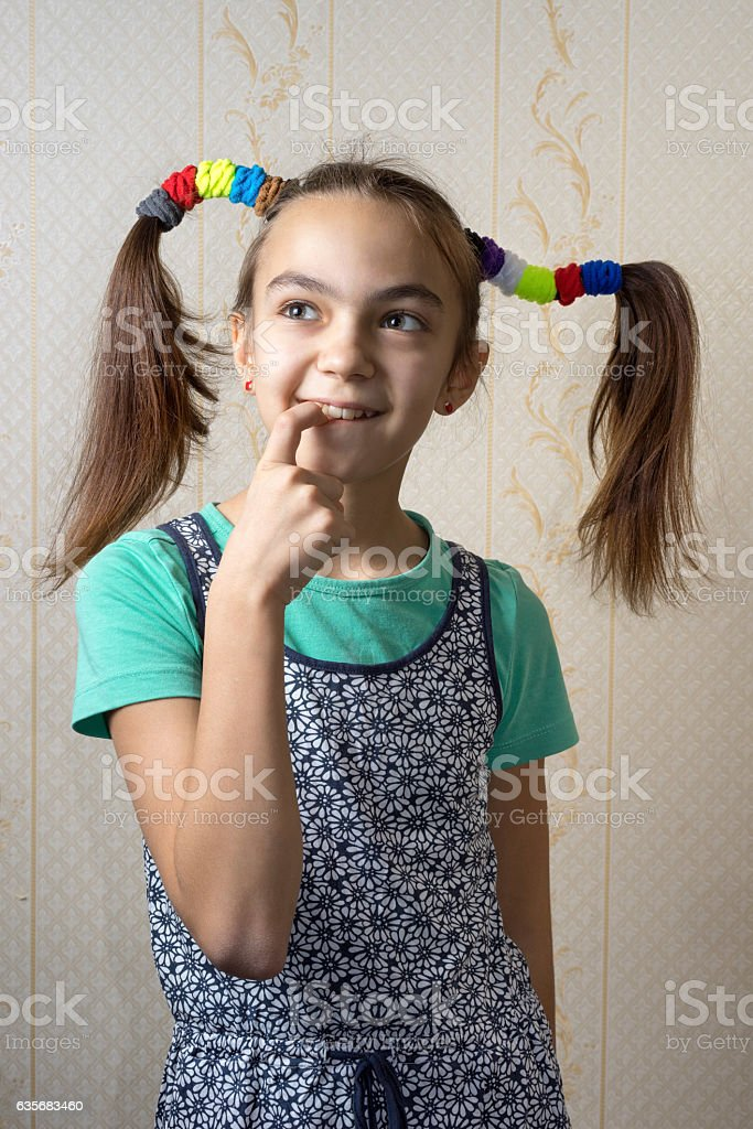 11 year old girl with pigtails like Pippi Longstocking stock photo