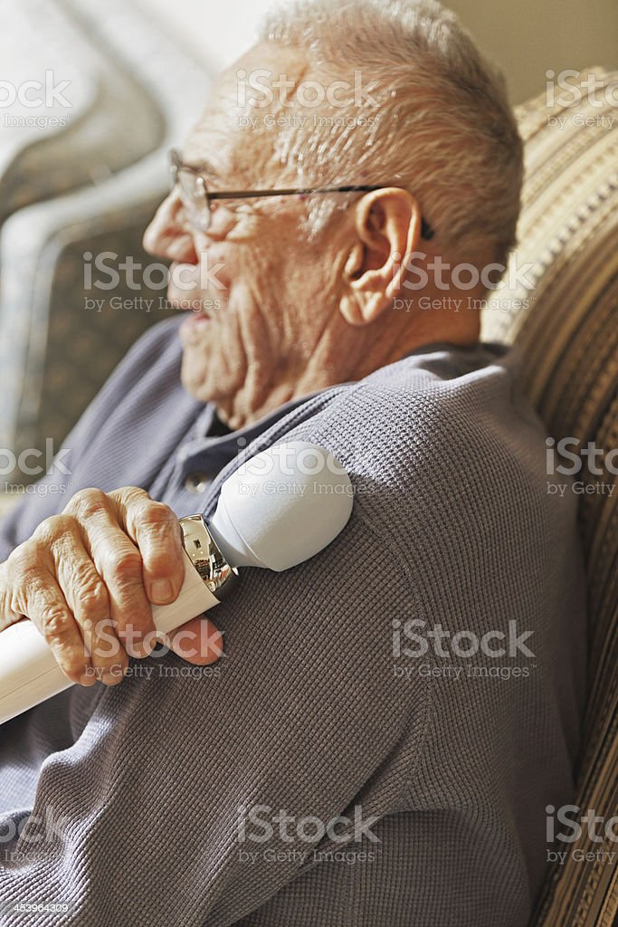 90 Year Old Man Massaging Sore Shoulder royalty-free stock photo