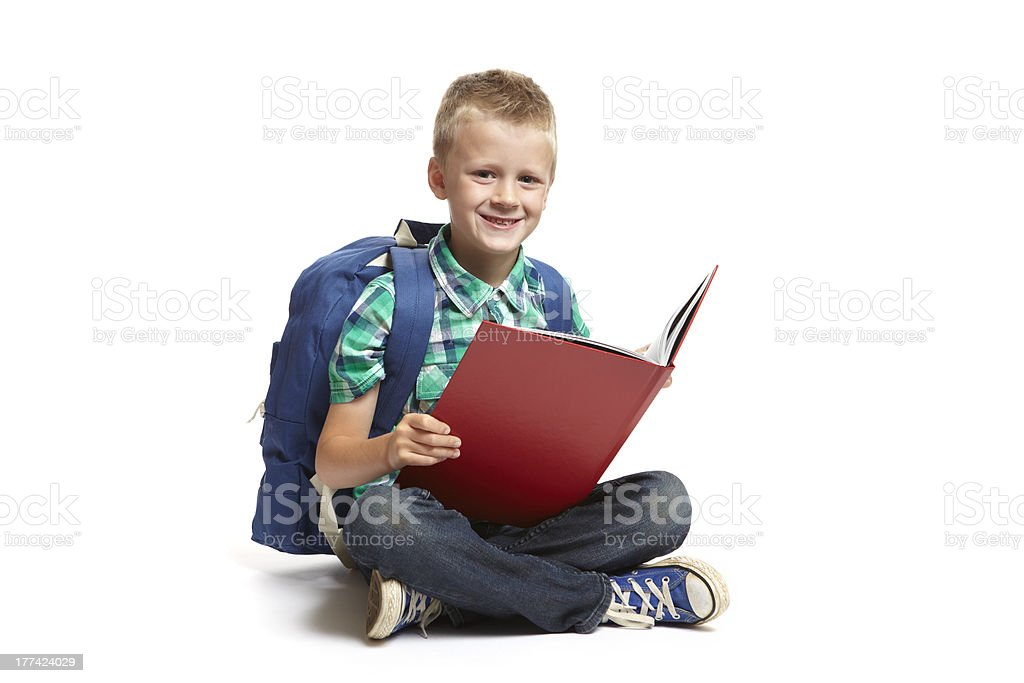 8 year old school boy reading on white background royalty-free stock photo