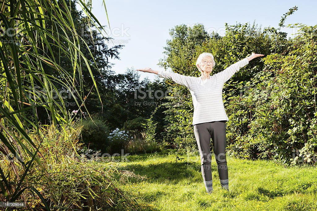 90 year old senior woman exercising outdoors royalty-free stock photo