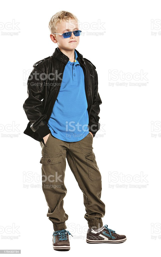 9 year old super-cool boy looks fashionable and confident stock photo