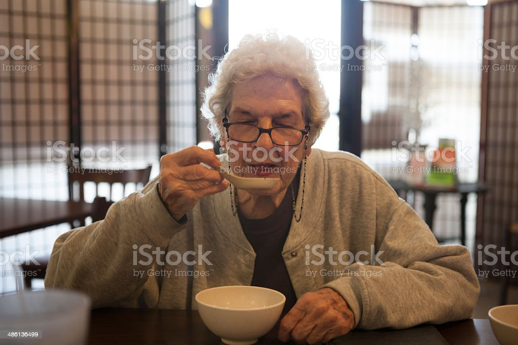 91 Year Old Woman Drinking Miso Soup stock photo