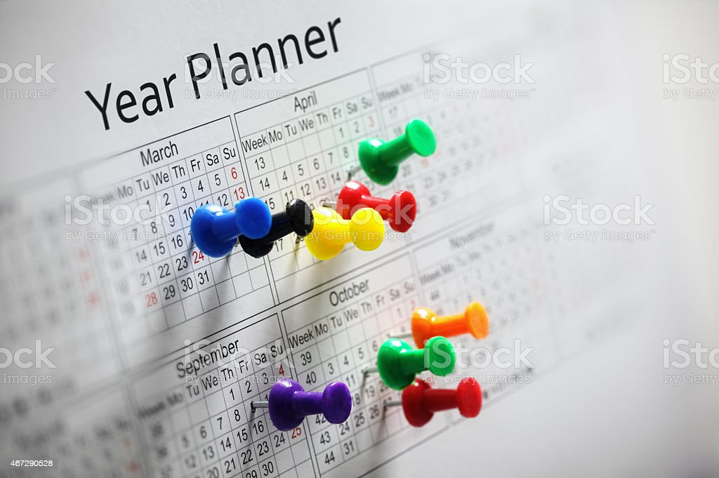 Year planner with thumbtacks stock photo