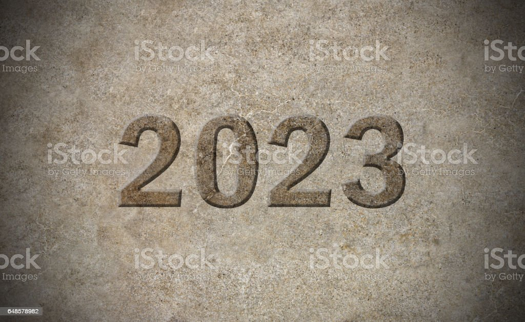 2023 year sign carved out in stone stock photo