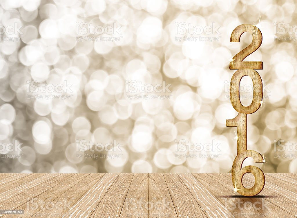 2016 year wood number in perspective room with sparkling bokeh stock photo